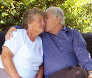 Couple of old swingers. Having a cuddle Stock Photo