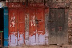 Old Door With Coca Cola Logo in Kathmandu royalty free stock photography