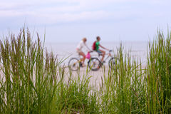 Couple On A Bike Ride Along The Beach Royalty Free Stock Image