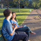 Couple On A Park Bench - Horizontal Stock Image