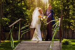 Couple On Bridge At Sunlight Royalty Free Stock Photos