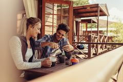 Free Couple On Holiday Having Coffee In Morning Royalty Free Stock Images - 122902419