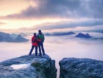 Free Couple On Mountain Looking Over Heavy Mist To  Horizon Stock Photos - 162150043