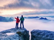 Free Couple On Mountain Looking Over Heavy Mist To  Horizon Royalty Free Stock Photography - 162150057