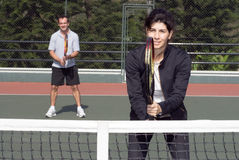Couple On Tennis Court - Horizontal Royalty Free Stock Images