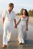 Couple On The Beach. Stock Photo