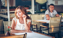 Couple in an open-air cafe Royalty Free Stock Photo