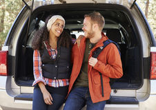 Couple at the open back car before a hike look at each other Stock Photo
