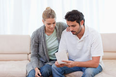 Couple opening an envelope Royalty Free Stock Photo