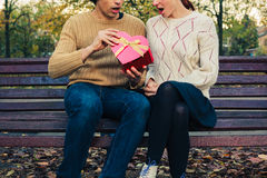 Couple opening heart shaped box Stock Images