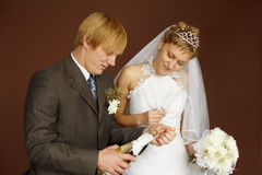 Couple opens a bottle of sparkling wine Stock Photos