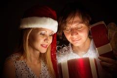 Couple opens a box of magic Stock Photos