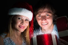 Couple opens a box of magic Royalty Free Stock Photos