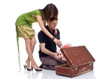 Couple opens a suitcase with a surprise Stock Image