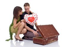 Couple opens a suitcase with a surprise Stock Photo
