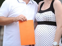 Couple with Orange Paper Royalty Free Stock Photos