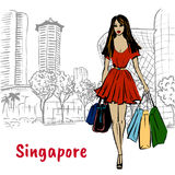 Couple on Orchard Road in Singapore. Hand-drawn sketch of woman with shopping bags on Orchard Road in Singapore Stock Image