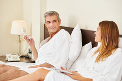 Couple ordering food from room service. In a hotel room with the telephone Royalty Free Stock Photography