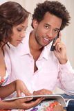 Couple ordering goods. Over the telephone Royalty Free Stock Photos