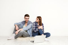 Couple ordering purchase on laptop computer Stock Photo