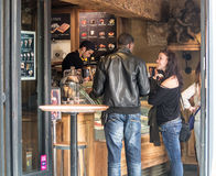 Couple orders gelato at Ile Saint-Louis shop in Paris, France Royalty Free Stock Photos