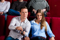 Couple and other people in cinema Royalty Free Stock Image