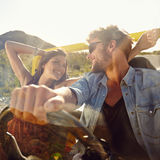 Couple out on a drive in open car Stock Images