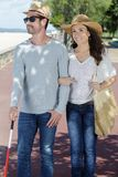Couple out for walk man visually impaired