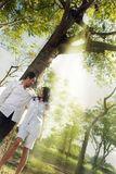 Couple outdoor. Portrait of couple outdoor with light ray Royalty Free Stock Images