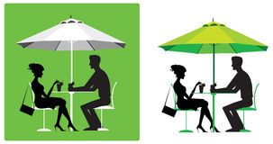 Couple at outdoor cafe. Silhouette of a couple at outdoor cafe Stock Photo