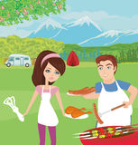 Couple outdoor grilling meat Royalty Free Stock Image