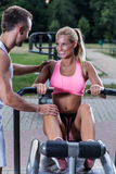 Couple on the outdoor gym Stock Photo