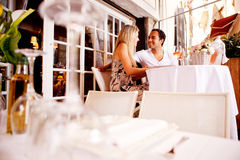 Couple in Outdoor Restaurant Royalty Free Stock Image
