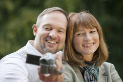 Couple outdoor with video camera Stock Image