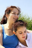Couple outdoors. 2 girls enjoying a sunny day Stock Photos