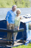 Couple outdoors on a boat smiling royalty free stock image