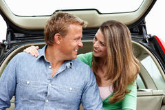 Couple outdoors with car Royalty Free Stock Images