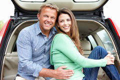 Couple outdoors with car Royalty Free Stock Photography