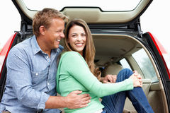 Couple outdoors with car Stock Images