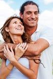 Couple outdoors embracing Stock Photos