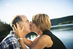 Couple outdoors by lake having good time Royalty Free Stock Photography