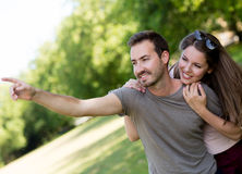 Couple outdoors looking at something Royalty Free Stock Photo