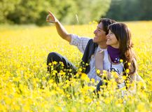 Couple outdoors pointing Royalty Free Stock Photo
