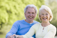 Couple outdoors smiling Stock Image