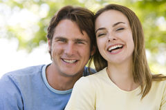 Couple outdoors smiling Royalty Free Stock Photography
