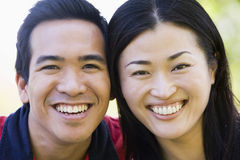 Couple outdoors smiling Royalty Free Stock Photo