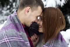 Couple outdoors under blanket Royalty Free Stock Photo