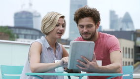 Couple In Outdoors In Urban Setting With Digital Tablet Royalty Free Stock Photo