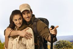 Couple outing in sunny weather. Happy young couple in trekker clothing outing in sunny weather Stock Images