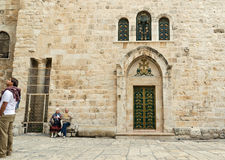 Couple outside the Church of the Holy Sepulchre stock photography